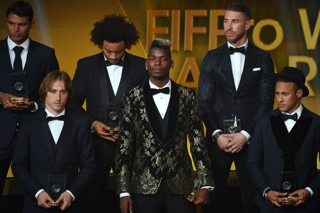 (From L) Brazil and Paris Saint-Germain defender Thiago Silva, Croatia and Real Madrid midfielder Luka Modric, Brazil and Real Madrid defender Marcelo, France and Juventus midfielder Paul Pogba, Spain and Real Madrid defender Sergio Ramos and Brazil and FC Barcelona forward Neymar pose on stage after being selected in the 2015 FIFA FIFPro World XI during the 2015 FIFA Ballon d'Or award ceremony at the Kongresshaus in Zurich on January 11, 2016. AFP PHOTO / OLIVIER MORIN / AFP / OLIVIER MORIN (Photo credit should read OLIVIER MORIN/AFP/Getty Images)