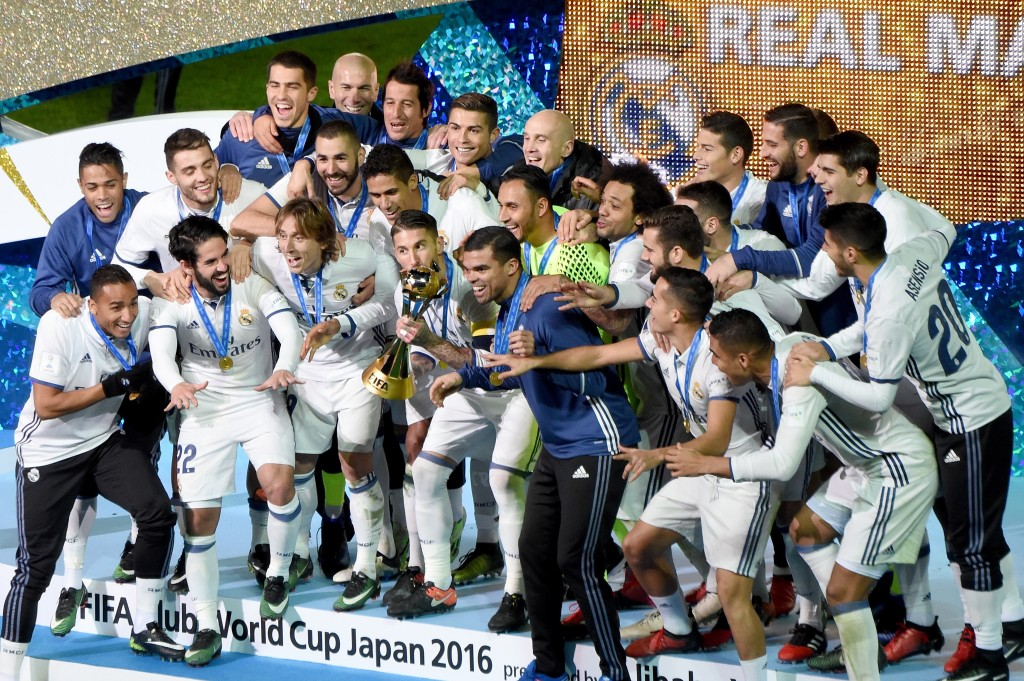 Real Madrid players and staff celebrate with their trophy after winning the Club World Cup football final match between Kashima Antlers of Japan and Real Madrid of Spain at Yokohama International stadium in Yokohama on December 18, 2016. / AFP / TORU YAMANAKA (Photo credit should read TORU YAMANAKA/AFP/Getty Images)