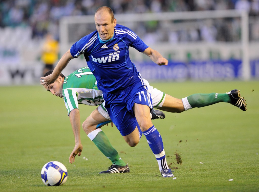 (FILES) -- A file photo taken on September 27, 2008 shows Real Madrid's Dutch winger Arjen Robben (R) fighting for the ball with Betis' Damia Abella during their Spanish league football match at the Ruiz de Lopera's stadium in Sevilla. Robben is doubtful for the derby against Atletico Madrid due to a thigh injury, Spanish sports daily As reported on October 7, 2008. Ex-Chelsea star Robben had been earlier ruled out of Holland's World Cup qualifiers against Iceland on Saturday and Norway on October 15. AFP PHOTO/ CRISTINA QUICLER (Photo credit should read CRISTINA QUICLER/AFP/Getty Images)