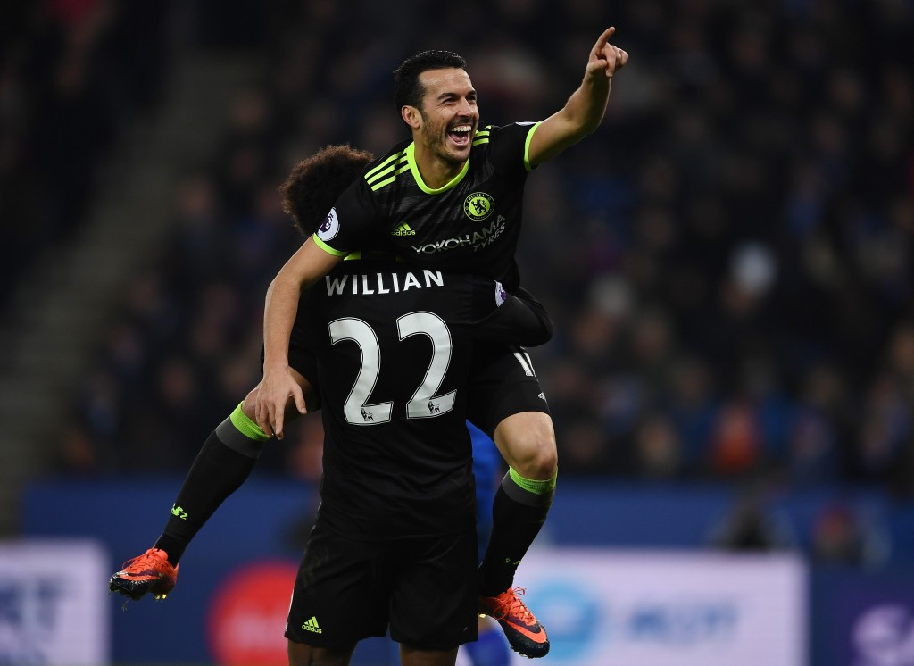 LEICESTER, ENGLAND - JANUARY 14: Pedro of Chelsea celebrates with teammate Willian of Chelsea after scoring their team's third goal during the Premier League match between Leicester City and Chelsea at The King Power Stadium on January 14, 2017 in Leicester, England. (Photo by Laurence Griffiths/Getty Images)