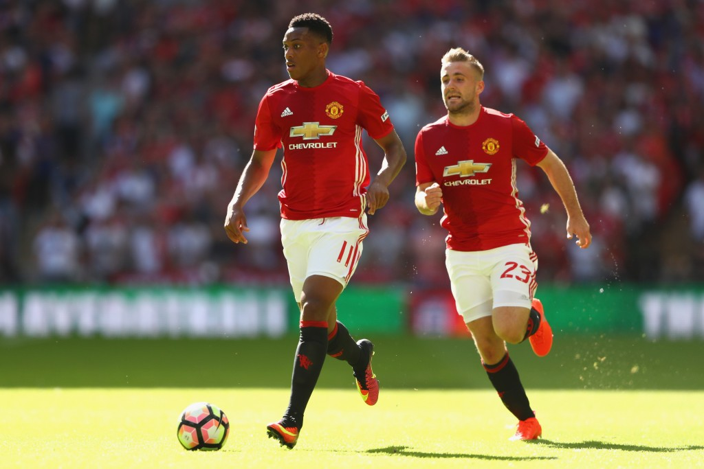 LONDON, ENGLAND - AUGUST 07: Anthony Martial (L) and Luke Shaw (R) of Manchester United during the Community Shield match between Leicester City and Manchester United at Wembley Stadium on August 7, 2016 in London, England. (Photo by Michael Steele/Getty Images)