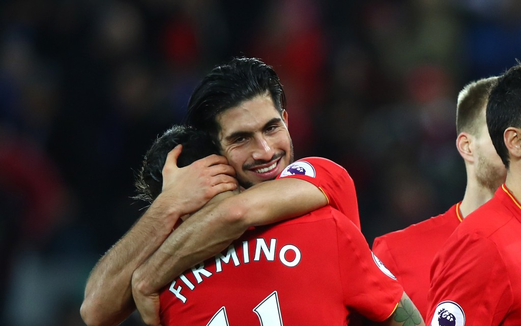LIVERPOOL, ENGLAND - DECEMBER 31: Roberto Firmino of Liverpool and Emre Can of Liverpool celebrate victory during the Premier League match between Liverpool and Manchester City at Anfield on December 31, 2016 in Liverpool, England. (Photo by Clive Brunskill/Getty Images)