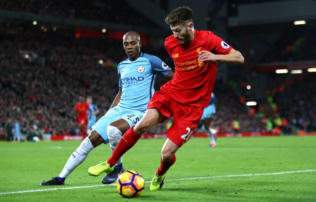 LIVERPOOL, ENGLAND - DECEMBER 31: Adam Lallana of Liverpool and Fernandinho of Manchester City in action during the Premier League match between Liverpool and Manchester City at Anfield on December 31, 2016 in Liverpool, England. (Photo by Clive Brunskill/Getty Images)