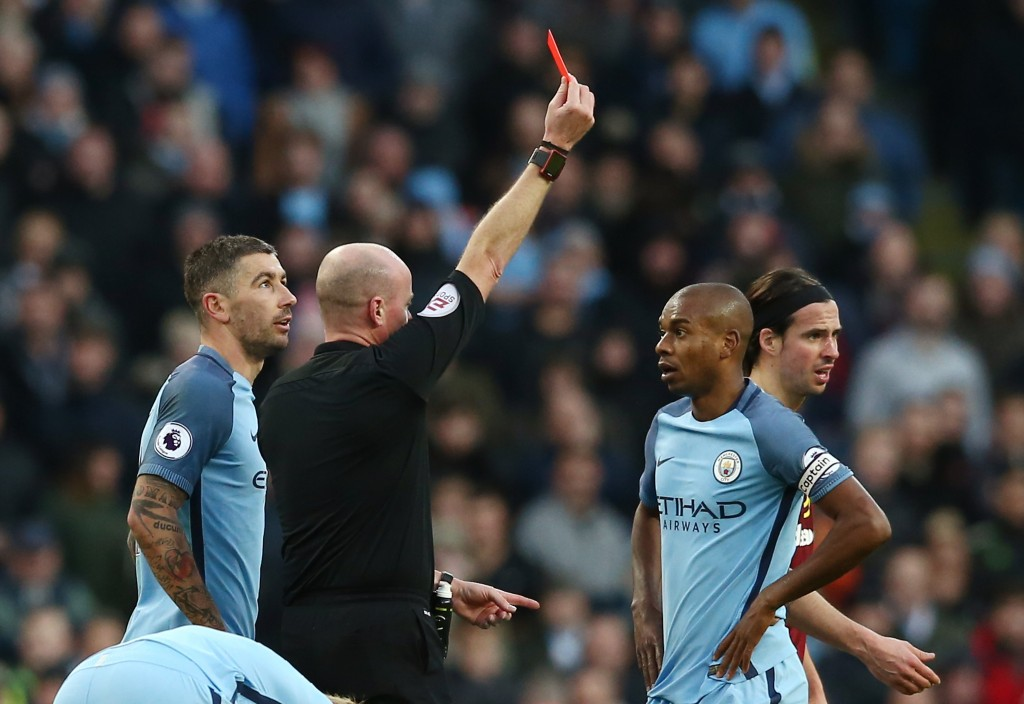 MANCHESTER, ENGLAND - JANUARY 02: Referee Lee Mason shows the red card to Fernandinho of Manchester City after his challenge on Johann Gudmundsson of Burnley during the Premier League match between Manchester City and Burnley at Etihad Stadium on January 2, 2017 in Manchester, England. (Photo by Jan Kruger/Getty Images)
