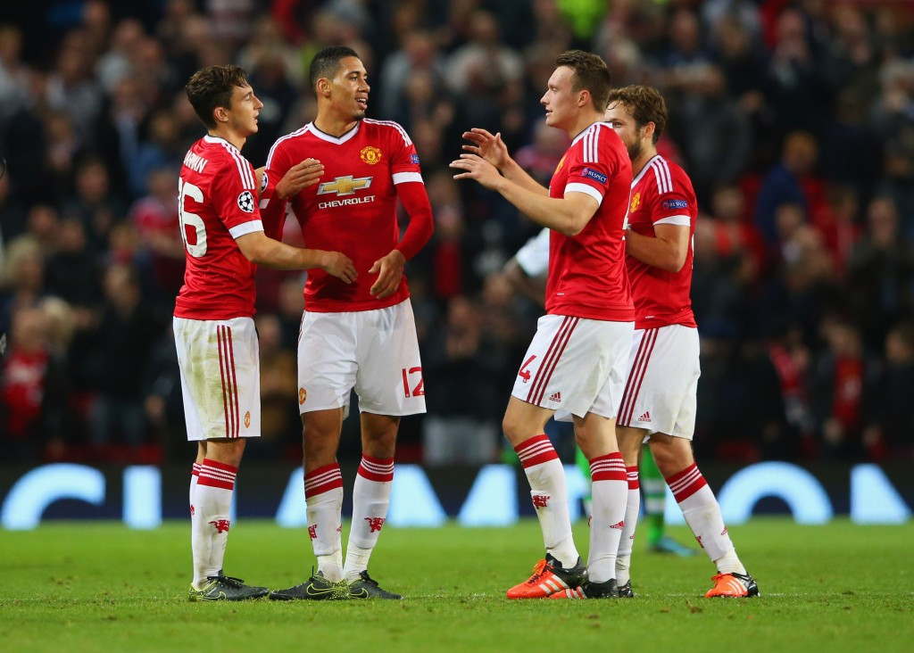 MANCHESTER, ENGLAND - SEPTEMBER 30: (L-R) Matteo Darmian, Chris Smalling, Phil Jones and Daley Blind of Manchester United celebrate victory after the UEFA Champions League Group B match between Manchester United FC and VfL Wolfsburg at Old Trafford on September 30, 2015 in Manchester, United Kingdom. (Photo by Alex Livesey/Bongarts/Getty Images)