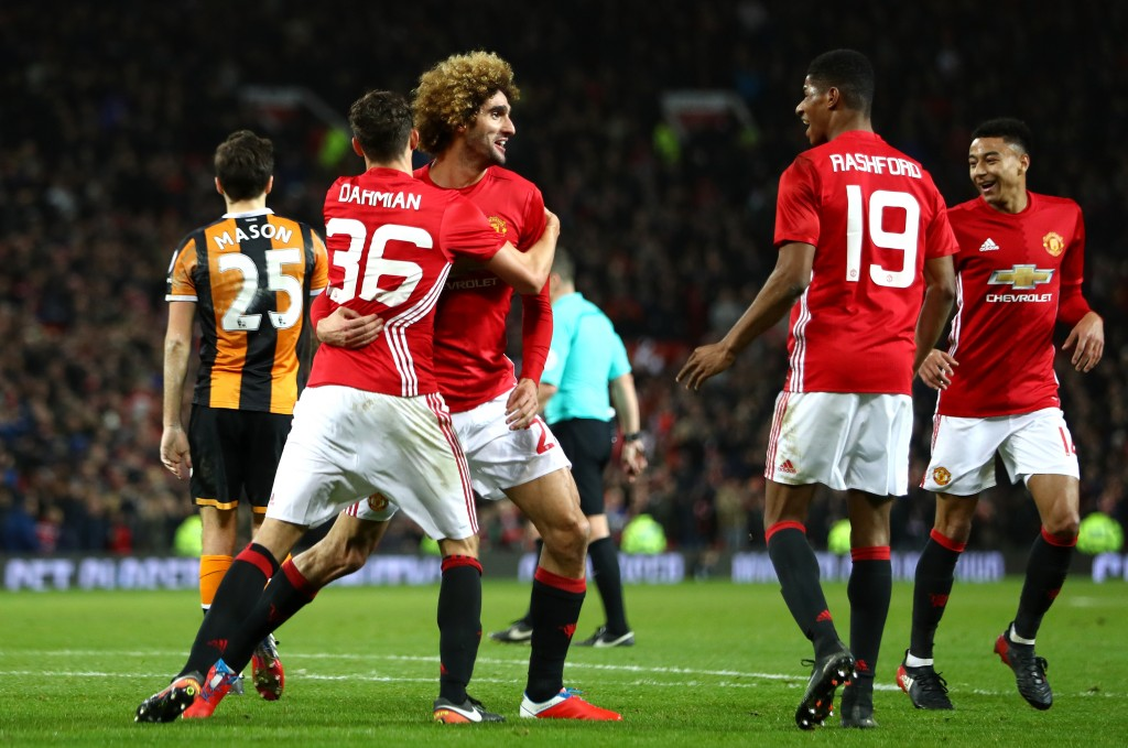 MANCHESTER, ENGLAND - JANUARY 10: Marouane Fellaini of Manchester United celebrates with team mates after scoring his sides second goal his sides second goal during the EFL Cup Semi-Final First Leg match between Manchester United and Hull City at Old Trafford on January 10, 2017 in Manchester, England. (Photo by Clive Mason/Getty Images)