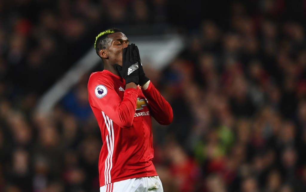 MANCHESTER, ENGLAND - JANUARY 15: Paul Pogba of Manchester United reacts during the Premier League match between Manchester United and Liverpool at Old Trafford on January 15, 2017 in Manchester, England. (Photo by Laurence Griffiths/Getty Images)
