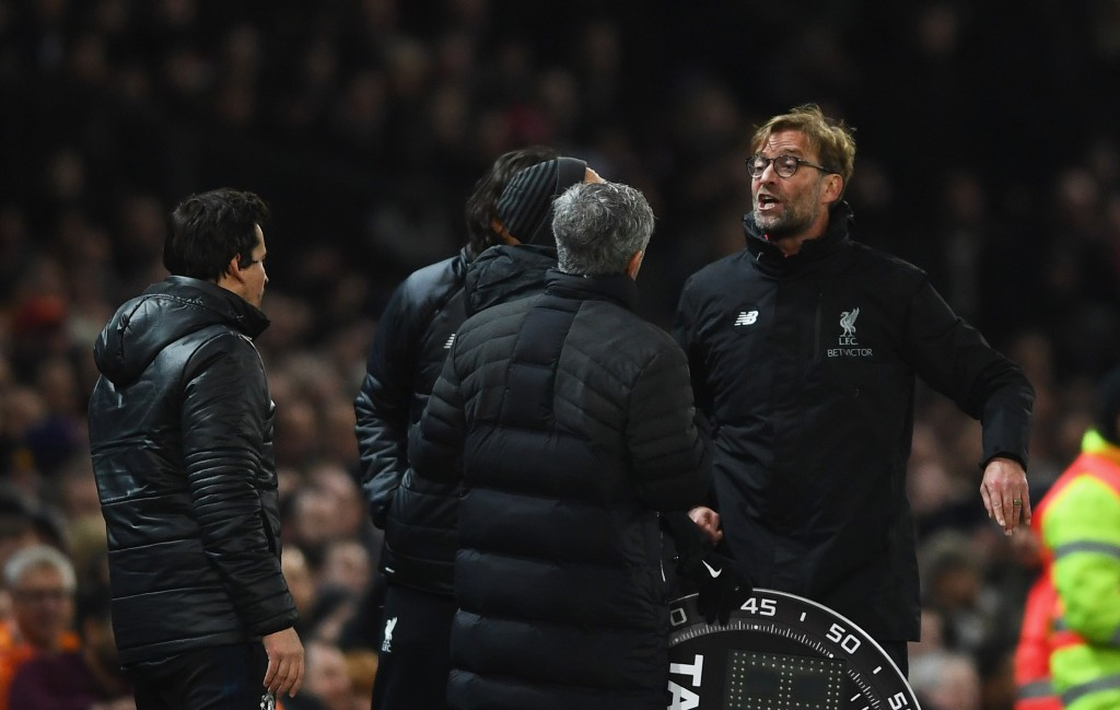MANCHESTER, ENGLAND - JANUARY 15: Jose Mourinho manager of Manchester United and Jurgen Klopp manager of Liverpool argue on the touchline the Premier League match between Manchester United and Liverpool at Old Trafford on January 15, 2017 in Manchester, England. (Photo by Laurence Griffiths/Getty Images)