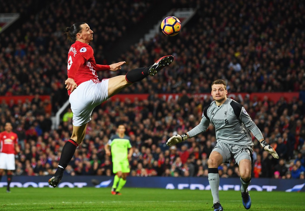 MANCHESTER, ENGLAND - JANUARY 15: Zlatan Ibrahimovic of Manchester United stretches for the ball as Simon Mignolet of Liverpool looks on during the Premier League match between Manchester United and Liverpool at Old Trafford on January 15, 2017 in Manchester, England. (Photo by Laurence Griffiths/Getty Images)