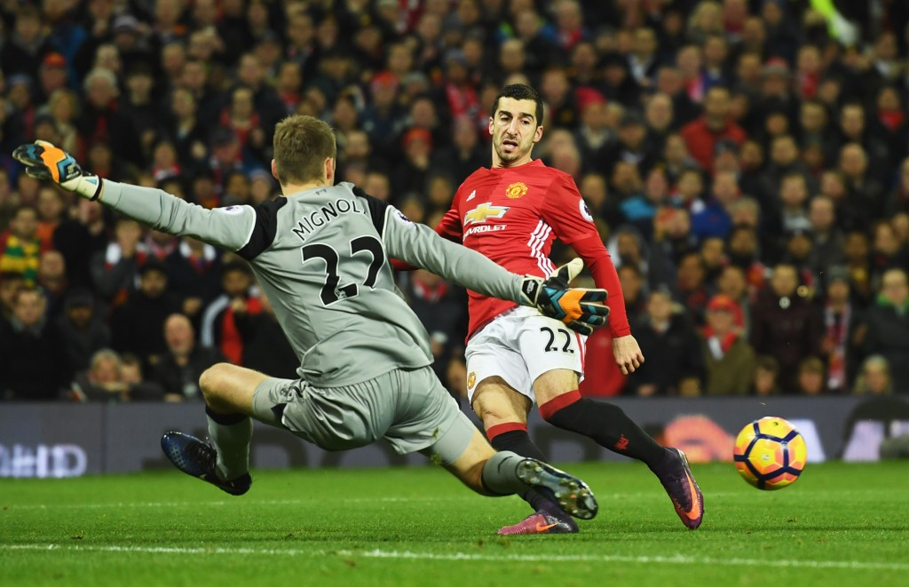 MANCHESTER, ENGLAND - JANUARY 15: Henrikh Mkhitaryan of Manchester United is faced by Simon Mignolet of Liverpool during the Premier League match between Manchester United and Liverpool at Old Trafford on January 15, 2017 in Manchester, England. (Photo by Mike Hewitt/Getty Images)