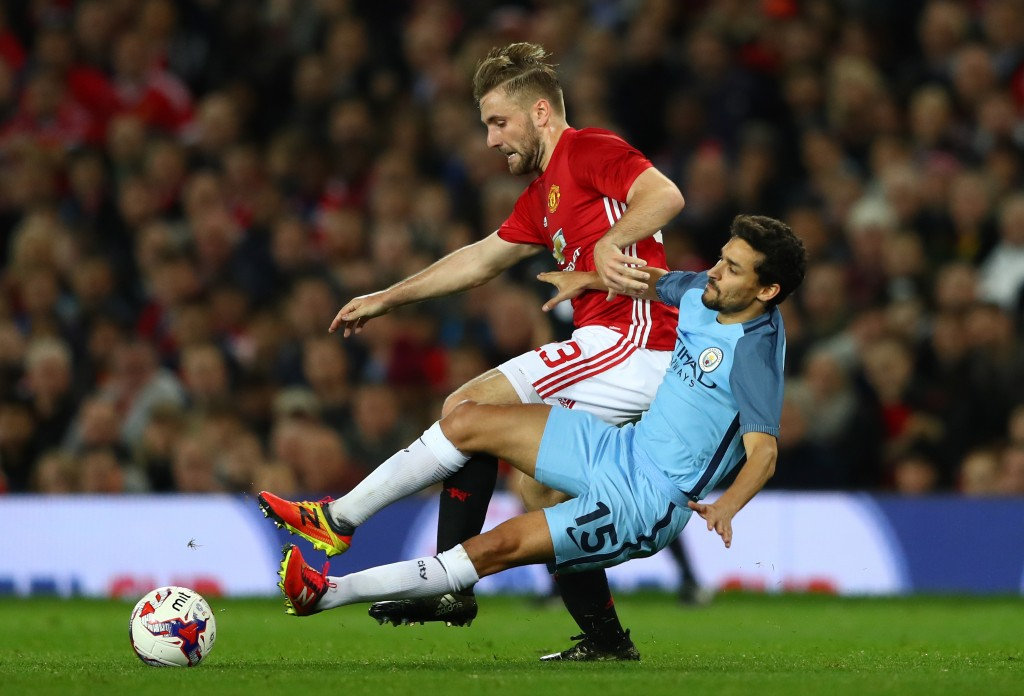 MANCHESTER, ENGLAND - OCTOBER 26: Luke Shaw of Manchester United (L) and Jesus Navas of Manchester City (R) battle for possession during the EFL Cup fourth round match between Manchester United and Manchester City at Old Trafford on October 26, 2016 in Manchester, England. (Photo by Michael Steele/Getty Images)