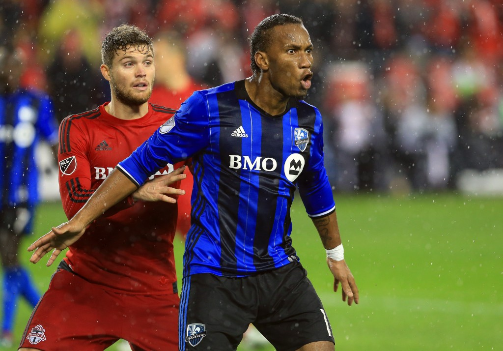 TORONTO, ON - NOVEMBER 30: Didier Drogba #11 of Montreal Impact battles with Eriq Zavaleta #15 of Toronto FC during the MLS Eastern Conference Final, Leg 2 game at BMO Field on November 30, 2016 in Toronto, Ontario, Canada. (Photo by Vaughn Ridley/Getty Images)