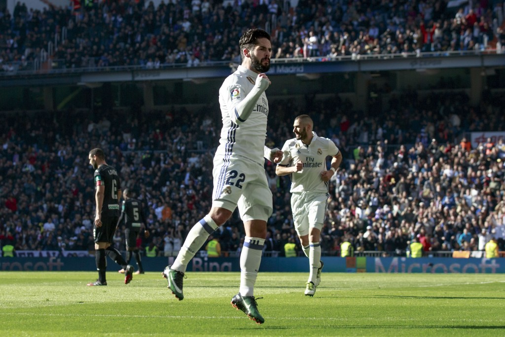 MADRID, SPAIN - JANUARY 07: Francisco Roman Alarcon alias Isco of Real Madrid CF celebrates scoring their opening goal during the La Liga match between Real Madrid CF and Granada CF at Estadio Santiago Bernabeu on January 7, 2017 in Madrid, Spain. (Photo by Gonzalo Arroyo Moreno/Getty Images)