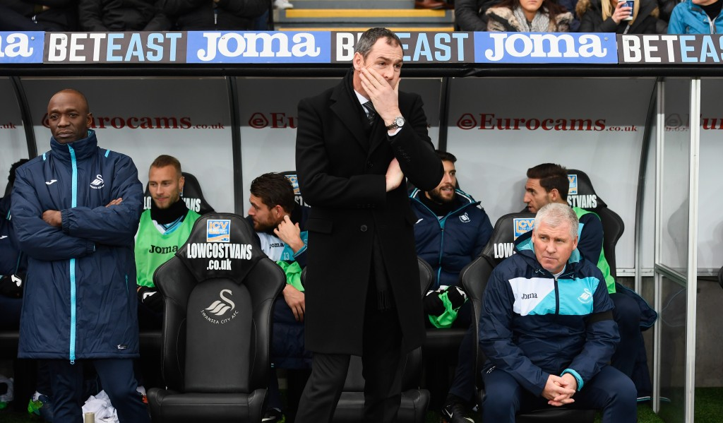 SWANSEA, WALES - JANUARY 14: Paul Clement manager of Swansea City looks on from the bench alongside new assistant Claude Makelele (L) prior to the Premier League match between Swansea City and Arsenal at Liberty Stadium on January 14, 2017 in Swansea, Wales. (Photo by Stu Forster/Getty Images)