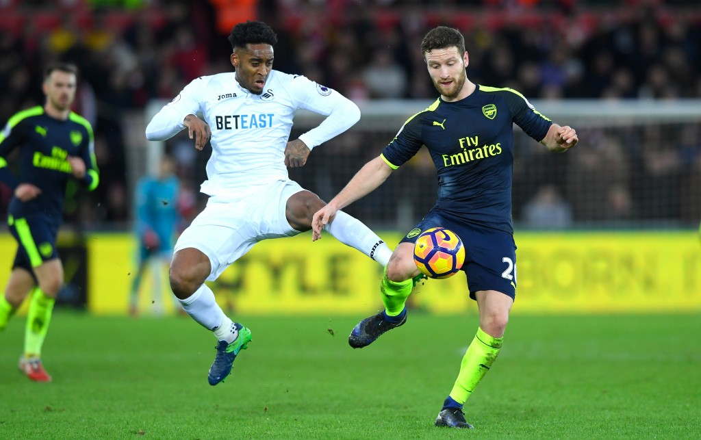 SWANSEA, WALES - JANUARY 14: Leroy Fer of Swansea City battles with Shkodran Mustafi of Arsenal during the Premier League match between Swansea City and Arsenal at Liberty Stadium on January 14, 2017 in Swansea, Wales. (Photo by Stu Forster/Getty Images)