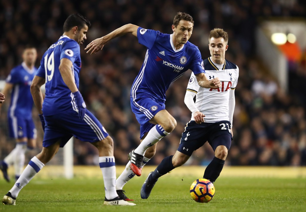 LONDON ENGLAND- JANUARY 04 Nemanja Matic of Chelsea attempts to take the ball past Christian Eriksen of Tottenham Hotspur during the Premier League match between Tottenham Hotspur and Chelsea at White Hart Lane