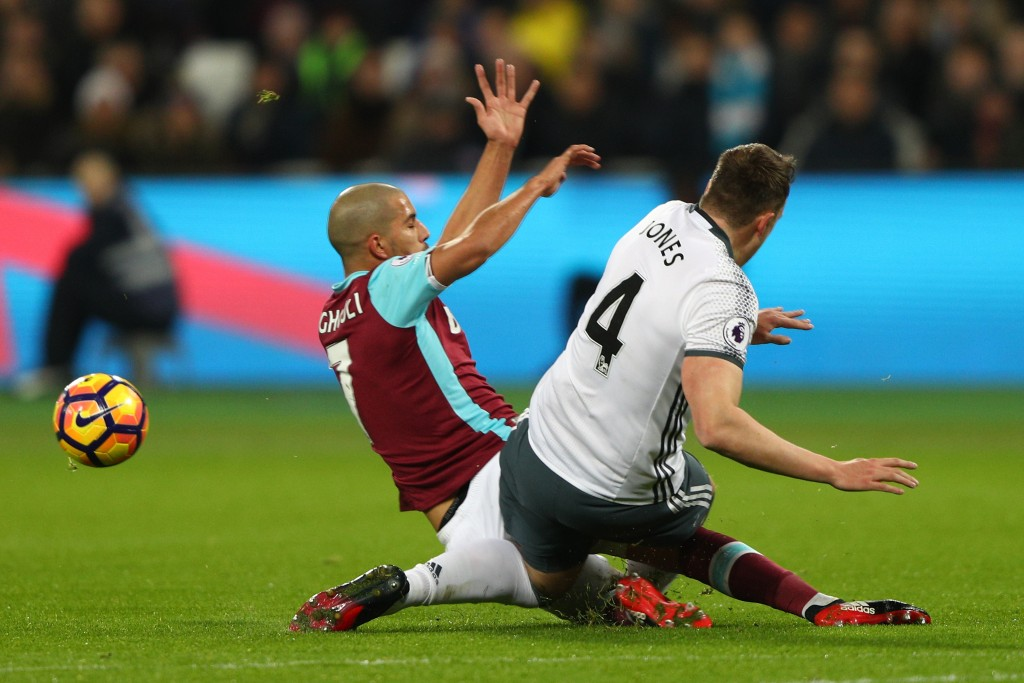STRATFORD, ENGLAND - JANUARY 02: Sofiane Feghouli of West Ham United challenges Phil Jones of Manchester United leading to his sending off during the Premier League match between West Ham United and Manchester United at London Stadium on January 2, 2017 in Stratford, England. (Photo by Ian Walton/Getty Images)
