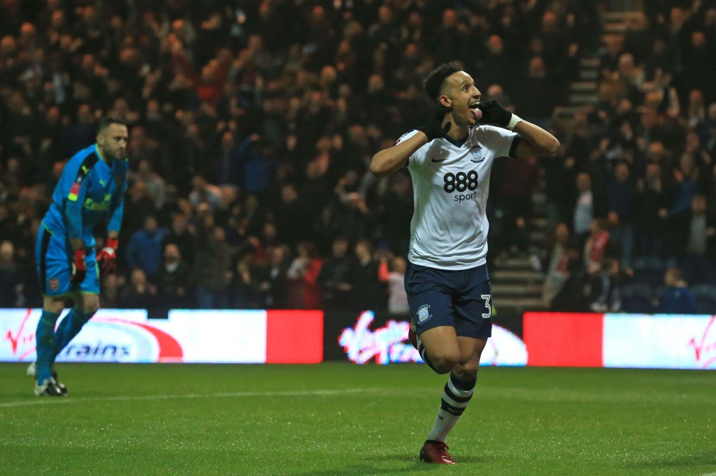 Preston's English striker Callum Robinson celebrates after scoring the opening goal as Arsenal's Colombian goalkeeper David Ospina (L) reacts during the English FA Cup third round football match between Preston North End and Arsenal at Deepdale in north west England on January 7, 2017. / AFP / Lindsey PARNABY / RESTRICTED TO EDITORIAL USE. No use with unauthorized audio, video, data, fixture lists, club/league logos or 'live' services. Online in-match use limited to 75 images, no video emulation. No use in betting, games or single club/league/player publications.  /         (Photo credit should read LINDSEY PARNABY/AFP/Getty Images)