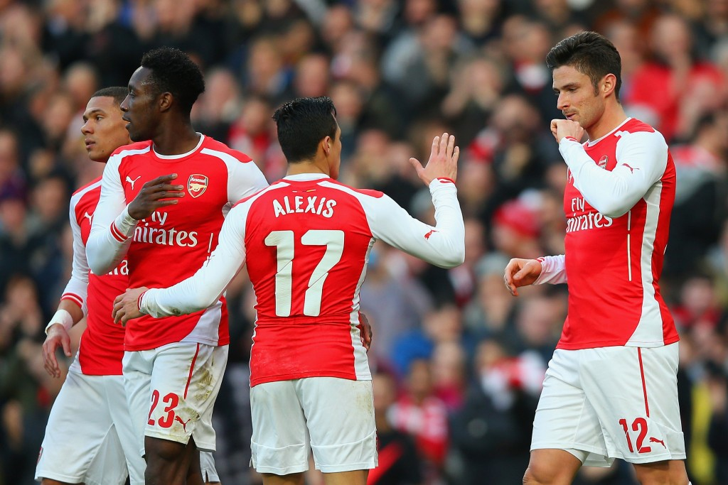 LONDON, ENGLAND - FEBRUARY 15: Olivier Giroud of Arsenal (R) celebrates with Alexis Sanchez and Danny Welbeck of Arsenal after scoring the opening goal during the FA Cup fifth round match between Arsenal and Middlesbrough at Emirates Stadium on February 15, 2015 in London, England. (Photo by Paul Gilham/Getty Images)