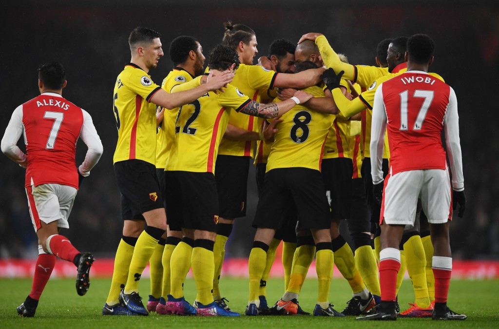 LONDON, ENGLAND - JANUARY 31: Younes Kaboul of Watford is mobbed by team mates after scoring the opening goal during the Premier League match between Arsenal and Watford at Emirates Stadium on January 31, 2017 in London, England. (Photo by Mike Hewitt/Getty Images)