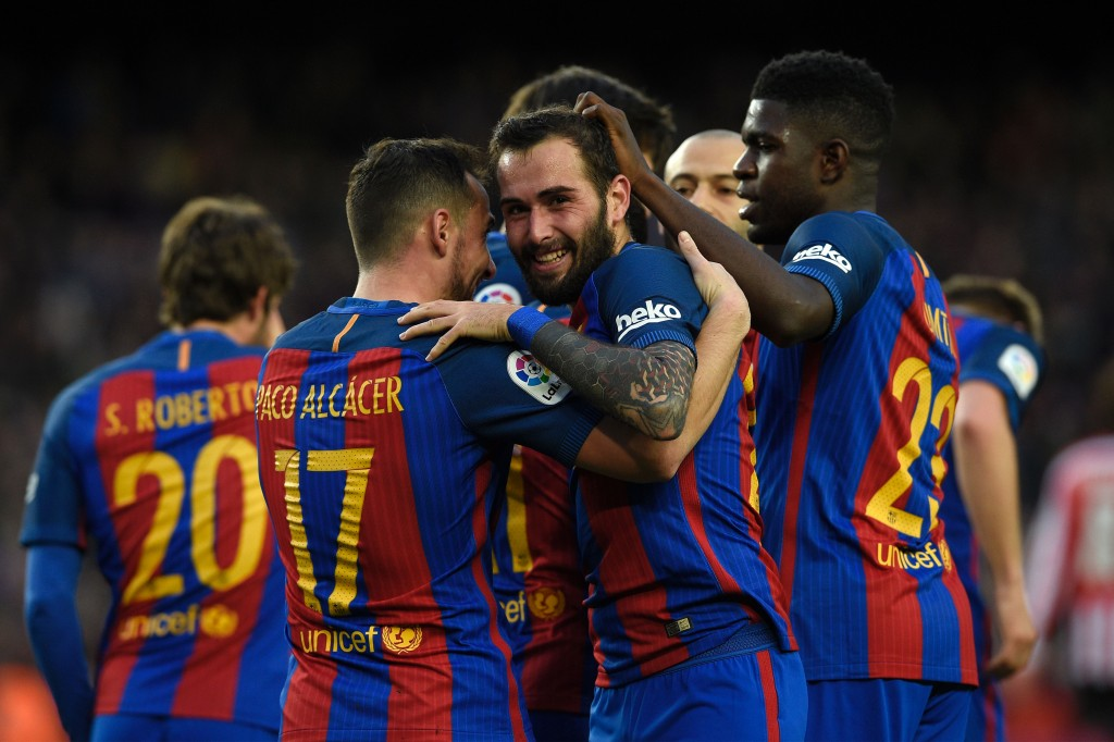 CORRECTION - Barcelona's defender Aleix Vidal (C) celebrates with teammates after scoring a goal during the Spanish league football match FC Barcelona vs Athletic Club Bilbao at the Camp Nou stadium in Barcelona on February 4, 2017. / AFP / LLUIS GENE / The erroneous mention[s] appearing in the metadata of this photo by LLUIS GENE has been modified in AFP systems in the following manner: [Barcelona's defender Aleix Vidal (C)] instead of [Barcelona's forward Paco Alcacer (2L)]. Please immediately remove the erroneous mention[s] from all your online services and delete it (them) from your servers. If you have been authorized by AFP to distribute it (them) to third parties, please ensure that the same actions are carried out by them. Failure to promptly comply with these instructions will entail liability on your part for any continued or post notification usage. Therefore we thank you very much for all your attention and prompt action. We are sorry for the inconvenience this notification may cause and remain at your disposal for any further information you may require. (Photo credit should read LLUIS GENE/AFP/Getty Images)