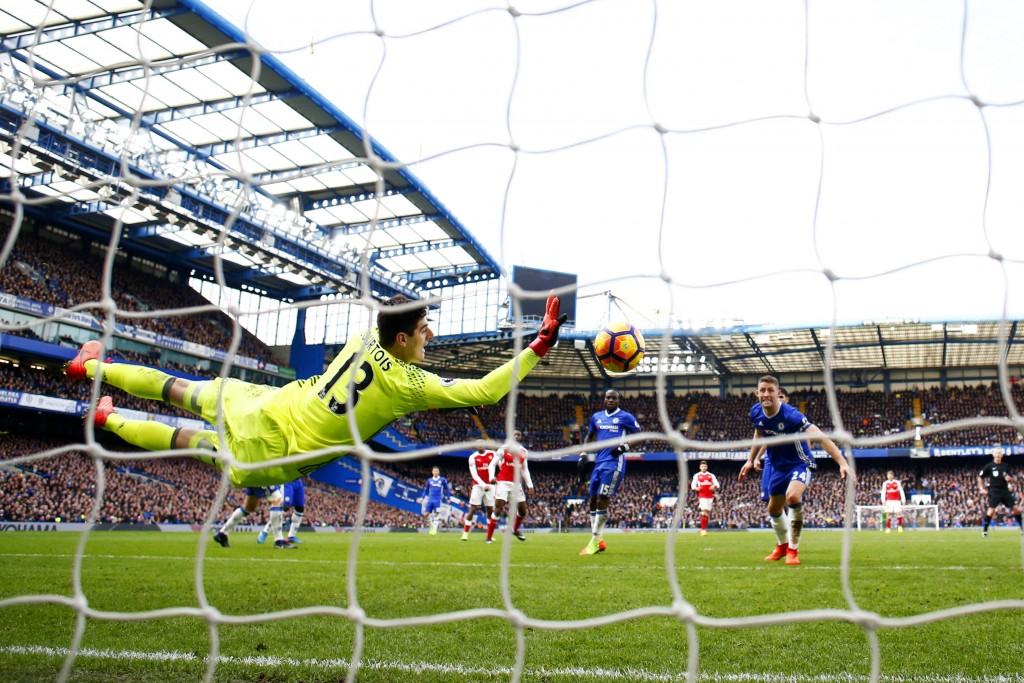 LONDON, ENGLAND - FEBRUARY 04: Thibaut Courtois of Chelsea makes a save during the Premier League match between Chelsea and Arsenal at Stamford Bridge on February 4, 2017 in London, England. (Photo by Clive Rose/Getty Images)