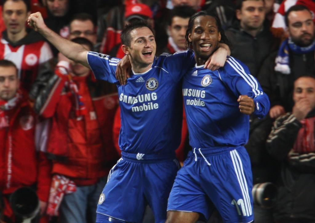LONDON - MARCH 05: Frank Lampard of Chelsea (L) celebrates with team mate Didier Drogba as he scores their second goal during the UEFA Champions League first knockout round, second leg match between Chelsea and Olympiakos at Stamford Bridge on March 5, 2008 in London, England. (Photo by Phil Cole/Getty Images)