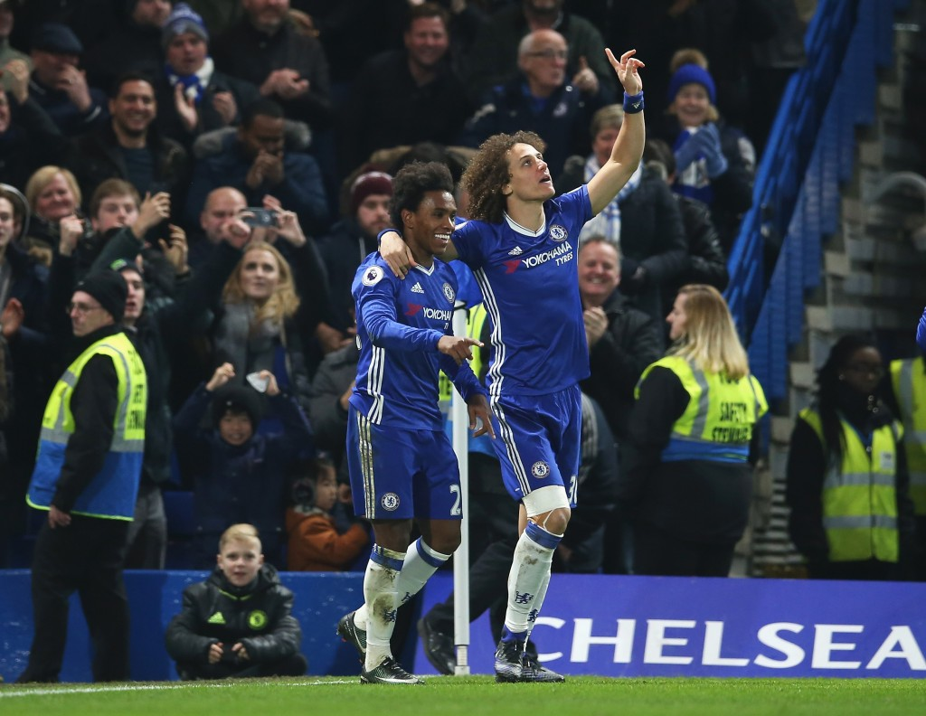 LONDON, ENGLAND - DECEMBER 31: Willian (L) of Chelsea celebrates scoring his team's second goal with his team mate David Luiz (R) during the Premier League match between Chelsea and Stoke City at Stamford Bridge on December 31, 2016 in London, England. (Photo by Steve Bardens/Getty Images)