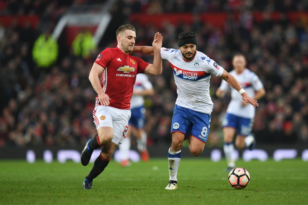 Manchester United's English defender Luke Shaw (R) vies with Wigan Athletic's English midfielder Sam Morsy (R) during the English FA Cup fourth round football match between Manchester United and Wigan Athletic at Old Trafford in Manchester, north west England, on January 29, 2017. / AFP / Paul ELLIS / RESTRICTED TO EDITORIAL USE. No use with unauthorized audio, video, data, fixture lists, club/league logos or 'live' services. Online in-match use limited to 75 images, no video emulation. No use in betting, games or single club/league/player publications. / (Photo credit should read PAUL ELLIS/AFP/Getty Images)