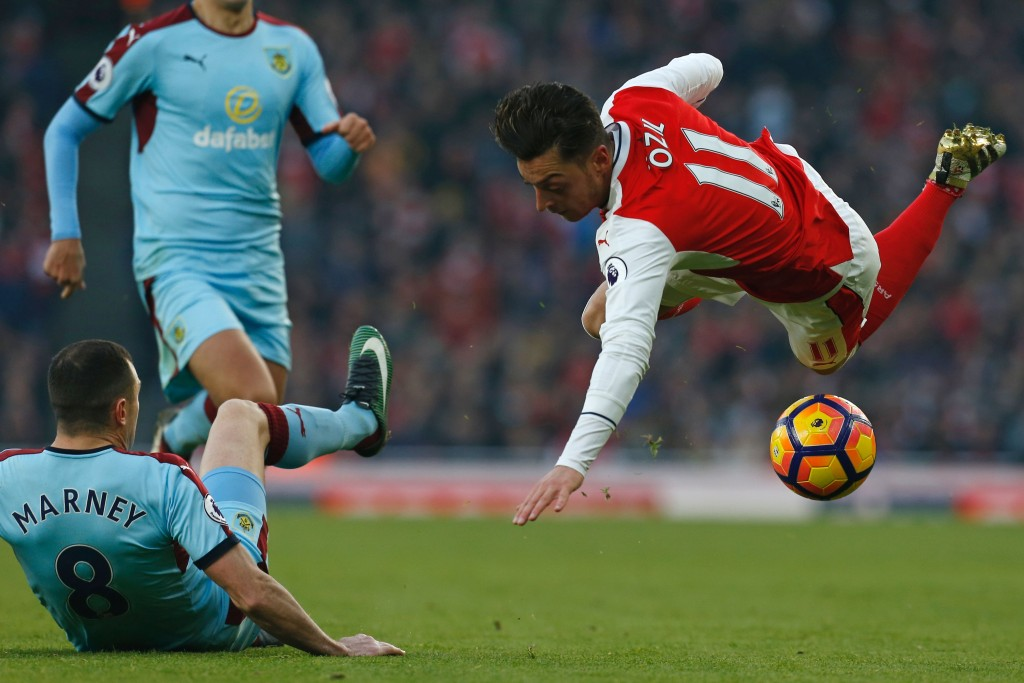 Arsenal's title challenge, a-la Ozil in the image, seems to be faltering, again. (Picture Courtesy - AFP/Getty Images)