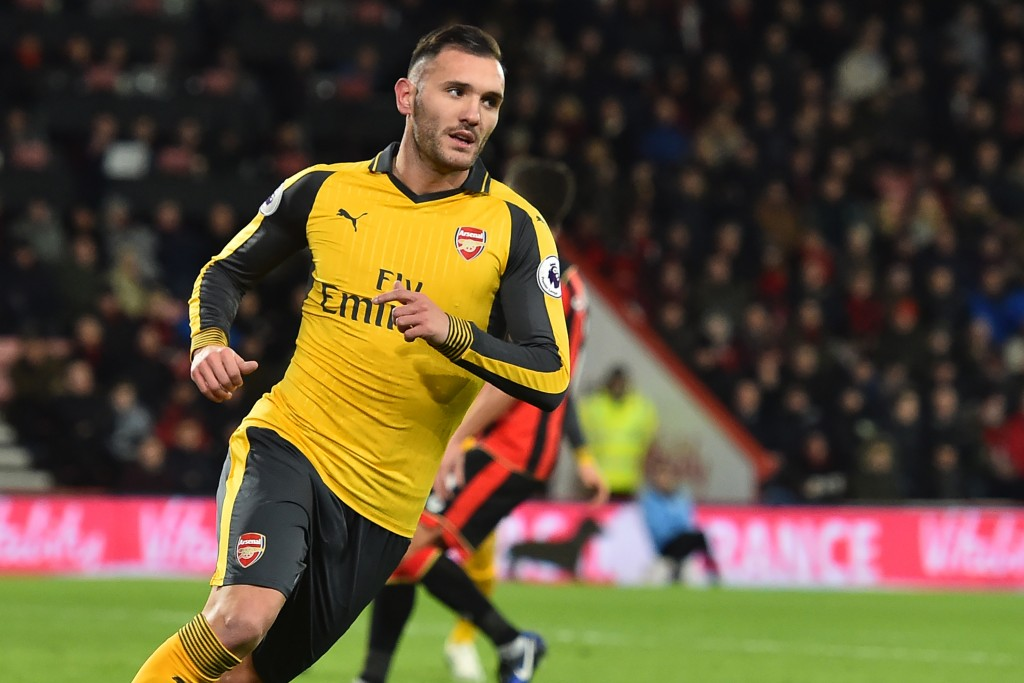 Arsenal's Spanish striker Lucas Perez celebrates after scoring their second goal during the English Premier League football match between Bournemouth and Arsenal at the Vitality Stadium in Bournemouth, southern England on January 3, 2017. / AFP / Glyn KIRK / RESTRICTED TO EDITORIAL USE. No use with unauthorized audio, video, data, fixture lists, club/league logos or 'live' services. Online in-match use limited to 75 images, no video emulation. No use in betting, games or single club/league/player publications. / (Photo credit should read GLYN KIRK/AFP/Getty Images)