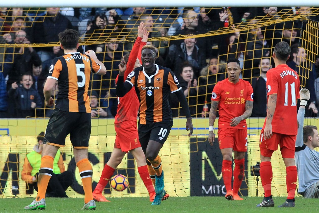 Hull City's French midfielder Alfred N'Diaye (C) celebrates after scoring the opening goal of the English Premier League football match between Hull City and Liverpool at the KCOM Stadium in Kingston upon Hull, north east England on February 4, 2017. / AFP / Lindsey PARNABY / RESTRICTED TO EDITORIAL USE. No use with unauthorized audio, video, data, fixture lists, club/league logos or 'live' services. Online in-match use limited to 75 images, no video emulation. No use in betting, games or single club/league/player publications. / (Photo credit should read LINDSEY PARNABY/AFP/Getty Images)