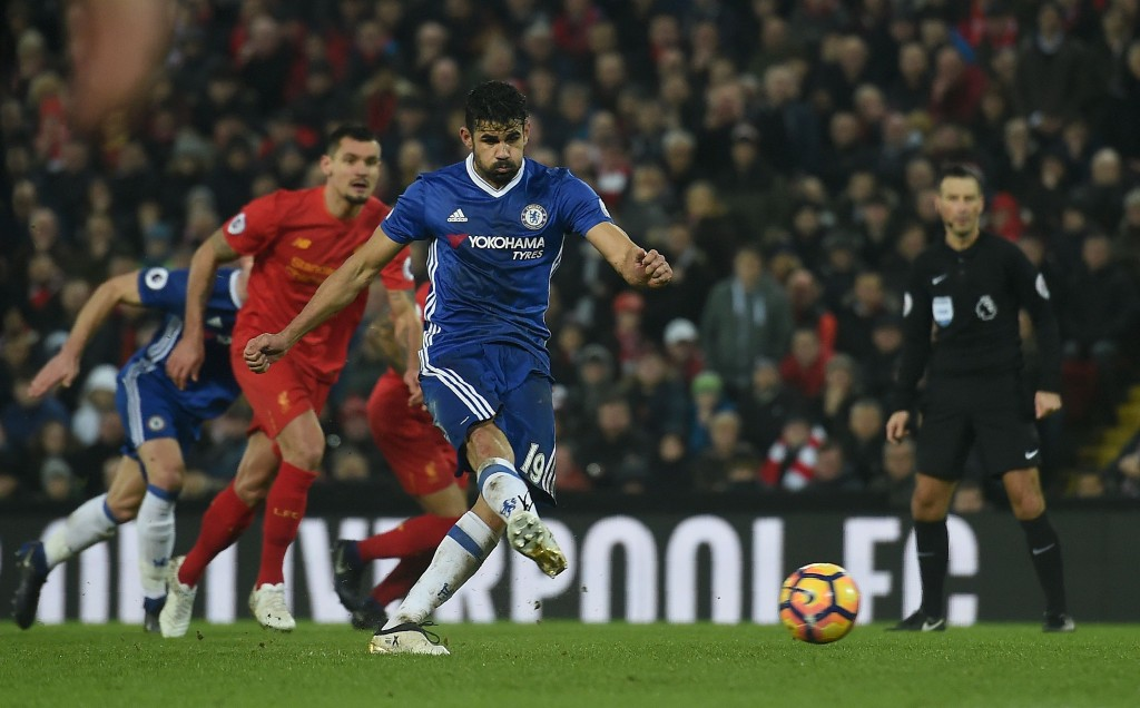 Chelsea's Brazilian-born Spanish striker Diego Costa takes a penalty but fails to score during the English Premier League football match between Liverpool and Chelsea at Anfield in Liverpool, north west England on January 31, 2017. The match ended in a draw at 1-1. / AFP / Paul ELLIS / RESTRICTED TO EDITORIAL USE. No use with unauthorized audio, video, data, fixture lists, club/league logos or 'live' services. Online in-match use limited to 75 images, no video emulation. No use in betting, games or single club/league/player publications. / The erroneous mention[s] appearing in the metadata of this photo by PAUL ELLIS has been modified in AFP systems in the following manner: [Chelsea's Brazilian-born Spanish striker Diego Costa makes a run on goal] instead of [Chelsea's Brazilian-born Spanish striker Diego Costa takes a penalty]. Please immediately remove the erroneous mention[s] from all your online services and delete it (them) from your servers. If you have been authorized by AFP to distribute it (them) to third parties, please ensure that the same actions are carried out by them. Failure to promptly comply with these instructions will entail liability on your part for any continued or post notification usage. Therefore we thank you very much for all your attention and prompt action. We are sorry for the inconvenience this notification may cause and remain at your disposal for any further information you may require. (Photo credit should read PAUL ELLIS/AFP/Getty Images)
