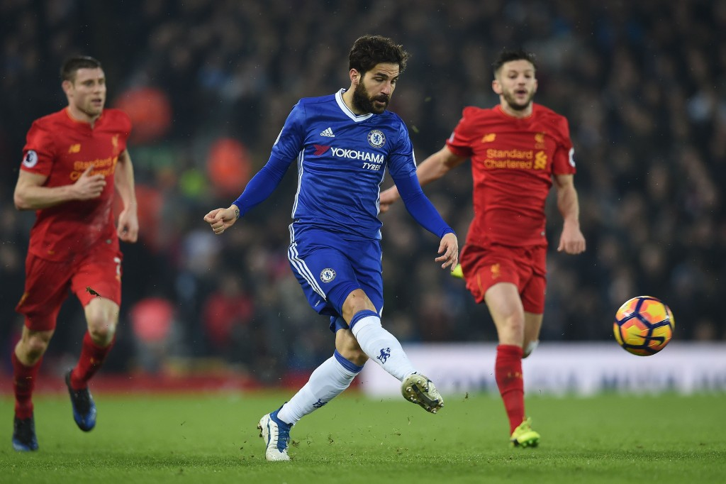 Chelsea's Spanish midfielder Cesc Fabregas (C) crosses the ball during the English Premier League football match between Liverpool and Chelsea at Anfield in Liverpool, north west England on January 31, 2017. The match ended in a draw at 1-1. / AFP / PAUL ELLIS / RESTRICTED TO EDITORIAL USE. No use with unauthorized audio, video, data, fixture lists, club/league logos or 'live' services. Online in-match use limited to 75 images, no video emulation. No use in betting, games or single club/league/player publications. / (Photo credit should read PAUL ELLIS/AFP/Getty Images)