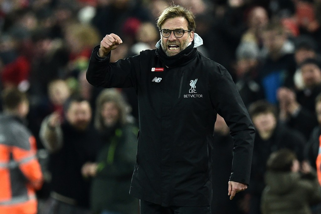 Liverpool's German manager Jurgen Klopp gestures on the touchline during the English Premier League football match between Liverpool and Tottenham Hotspur at Anfield in Liverpool, north west England on February 11, 2017. / AFP / Oli SCARFF / RESTRICTED TO EDITORIAL USE. No use with unauthorized audio, video, data, fixture lists, club/league logos or 'live' services. Online in-match use limited to 75 images, no video emulation. No use in betting, games or single club/league/player publications. / (Photo credit should read OLI SCARFF/AFP/Getty Images)