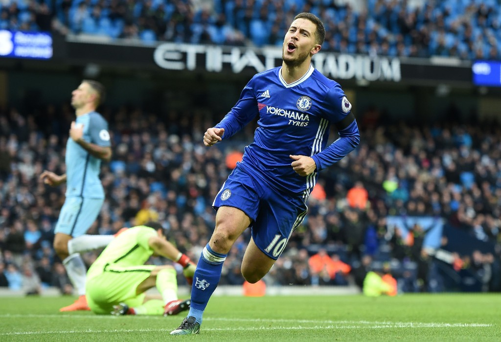 Chelsea's Belgian midfielder Eden Hazard celebrates scoring his team's third goal during the English Premier League football match between Manchester City and Chelsea at the Etihad Stadium in Manchester, north west England, on December 3, 2016. / AFP / Paul ELLIS / RESTRICTED TO EDITORIAL USE. No use with unauthorized audio, video, data, fixture lists, club/league logos or 'live' services. Online in-match use limited to 75 images, no video emulation. No use in betting, games or single club/league/player publications. / (Photo credit should read PAUL ELLIS/AFP/Getty Images)