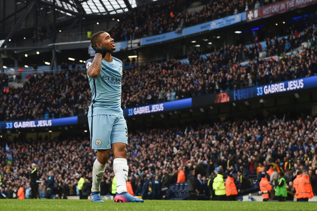 Manchester City's Brazilian striker Gabriel Jesus celebrates after scoring their late winning goal during the English Premier League football match between Manchester City and Swansea City at the Etihad Stadium in Manchester, north west England, on February 5, 2017. Manchester City won the game 2-1. / AFP / PAUL ELLIS / RESTRICTED TO EDITORIAL USE. No use with unauthorized audio, video, data, fixture lists, club/league logos or 'live' services. Online in-match use limited to 75 images, no video emulation. No use in betting, games or single club/league/player publications. / (Photo credit should read PAUL ELLIS/AFP/Getty Images)