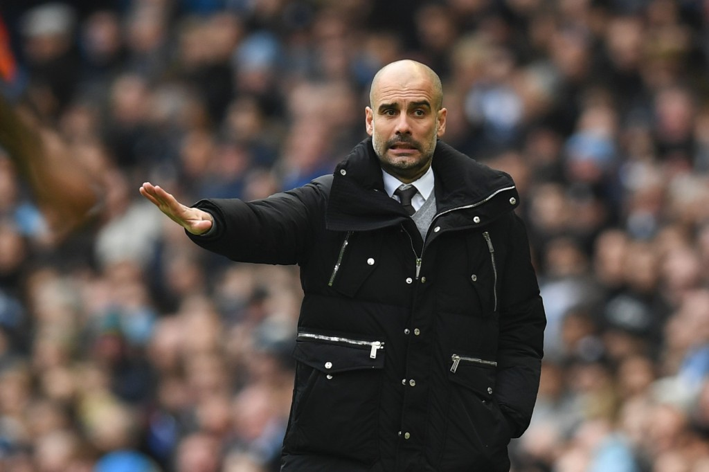 Manchester City's Spanish manager Pep Guardiola gestures on the touchline during the English Premier League football match between Manchester City and Swansea City at the Etihad Stadium in Manchester, north west England, on February 5, 2017. / AFP / Paul ELLIS / RESTRICTED TO EDITORIAL USE. No use with unauthorized audio, video, data, fixture lists, club/league logos or 'live' services. Online in-match use limited to 75 images, no video emulation. No use in betting, games or single club/league/player publications. / (Photo credit should read PAUL ELLIS/AFP/Getty Images)