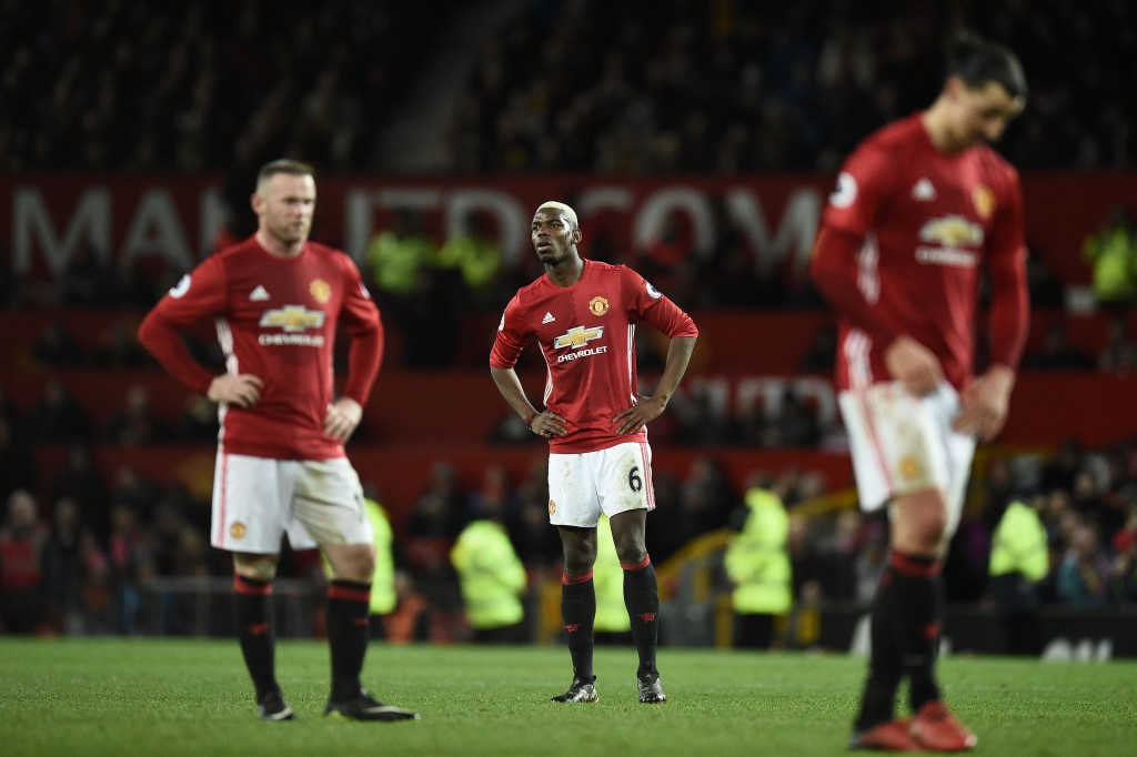 Manchester United's English striker Wayne Rooney (L) Manchester United's French midfielder Paul Pogba and Manchester United's Swedish striker Zlatan Ibrahimovic react following the English Premier League football match between Manchester United and Hull City at Old Trafford in Manchester, north west England, on February 1, 2017. The match ended in a draw at 0-0. / AFP / Oli SCARFF / RESTRICTED TO EDITORIAL USE. No use with unauthorized audio, video, data, fixture lists, club/league logos or 'live' services. Online in-match use limited to 75 images, no video emulation. No use in betting, games or single club/league/player publications. / (Photo credit should read OLI SCARFF/AFP/Getty Images)