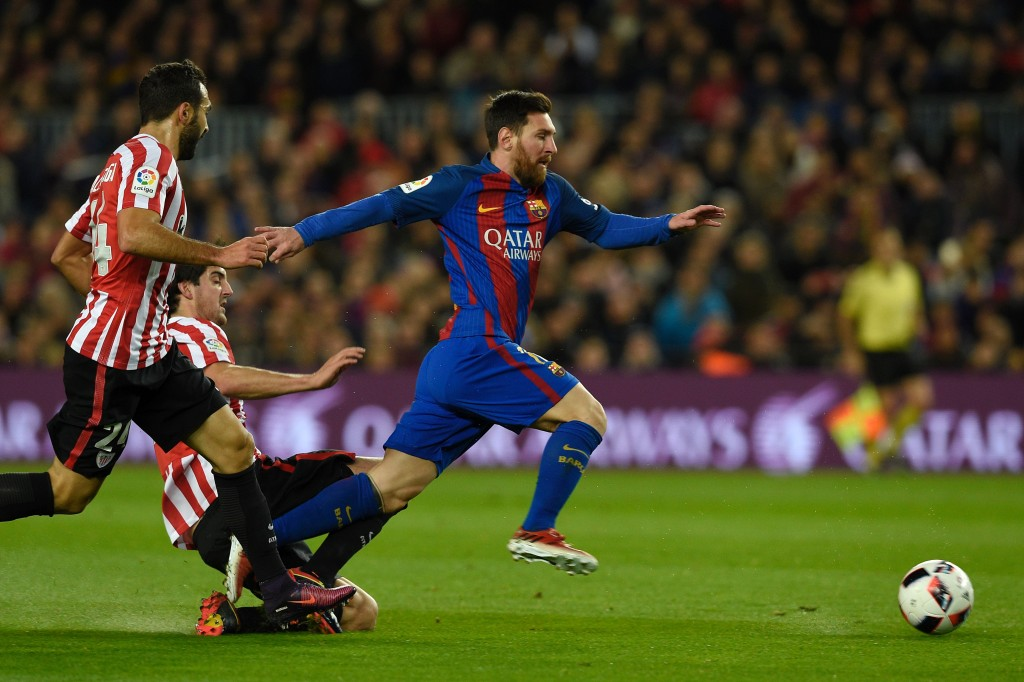 Barcelona's Argentinian forward Lionel Messi (R) vies with Athletic Bilbao's defender Mikel San Jose (C) and Athletic Bilbao's defender Mikel Balenciaga (L) during the Spanish Copa del Rey (King's Cup) round of 16 second leg football match FC Barcelona vs Athletic Club de Bilbao at the Camp Nou stadium in Barcelona on January 11, 2017. / AFP / LLUIS GENE (Photo credit should read LLUIS GENE/AFP/Getty Images)