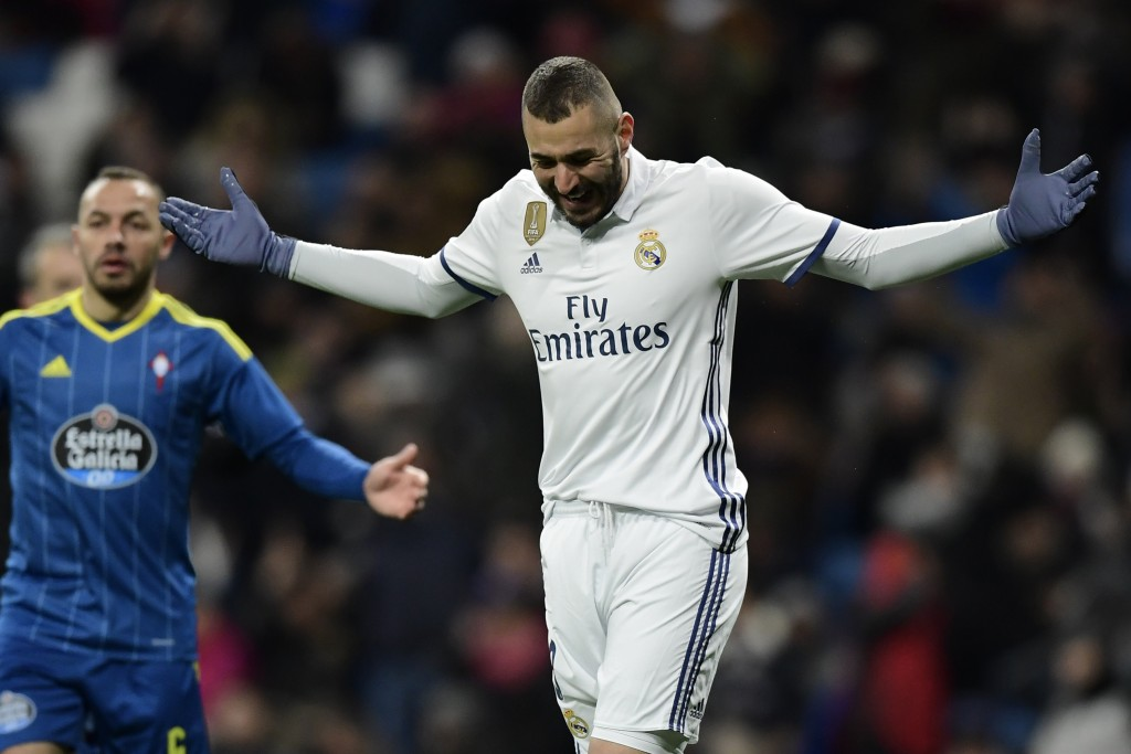 Real Madrid's French forward Karim Benzema gestures after missing a goal opportunity during the Spanish Copa del Rey (King's Cup) quarter-final first leg football match Real Madrid CF vs RC Celta de Vigo at the Santiago Bernabeu stadium in Madrid on January 18, 2017. / AFP / JAVIER SORIANO (Photo credit should read JAVIER SORIANO/AFP/Getty Images)