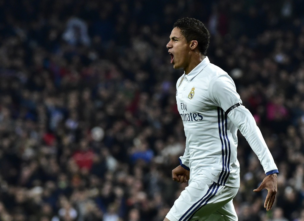Real Madrid's French defender Raphael Varane celebrates after scoring during the Spanish Copa del Rey (King's Cup) round of 16 first leg football match Real Madrid CF vs Sevilla FC at the Santiago Bernabeu stadium in Madrid on January 4, 2017. / AFP / GERARD JULIEN (Photo credit should read GERARD JULIEN/AFP/Getty Images)