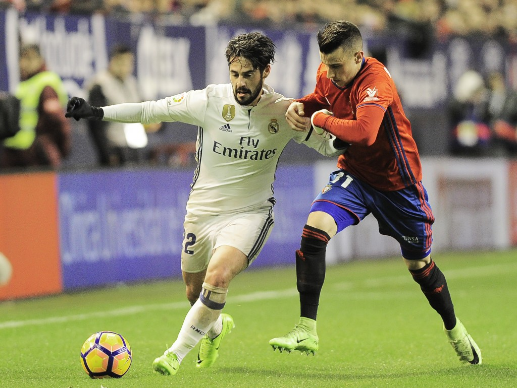 Real Madrid's midfielder Francisco Roman (L) vies with Osasuna's midfielder Alex Berenguer (R) during the Spanish league football match CA Osasuna vs Real Madrid CF at El Sadar stadium in Pamplona on February 11, 2017. / AFP / ANDER GILLENEA (Photo credit should read ANDER GILLENEA/AFP/Getty Images)