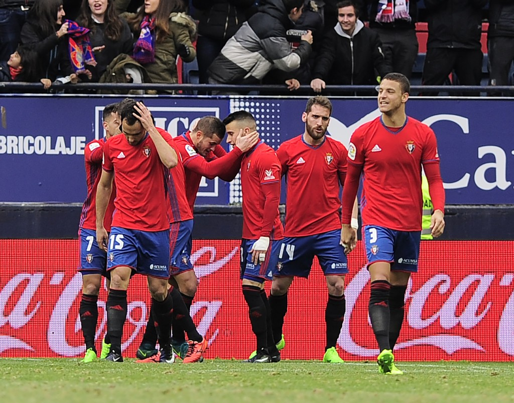Osasuna's players celebrate after scoring their team's second goal during the Spanish league football match CA Osasuna vs Sevilla FC at El Sadar stadium in Pamplona on January 22, 2017. / AFP / ANDER GILLENEA (Photo credit should read ANDER GILLENEA/AFP/Getty Images)