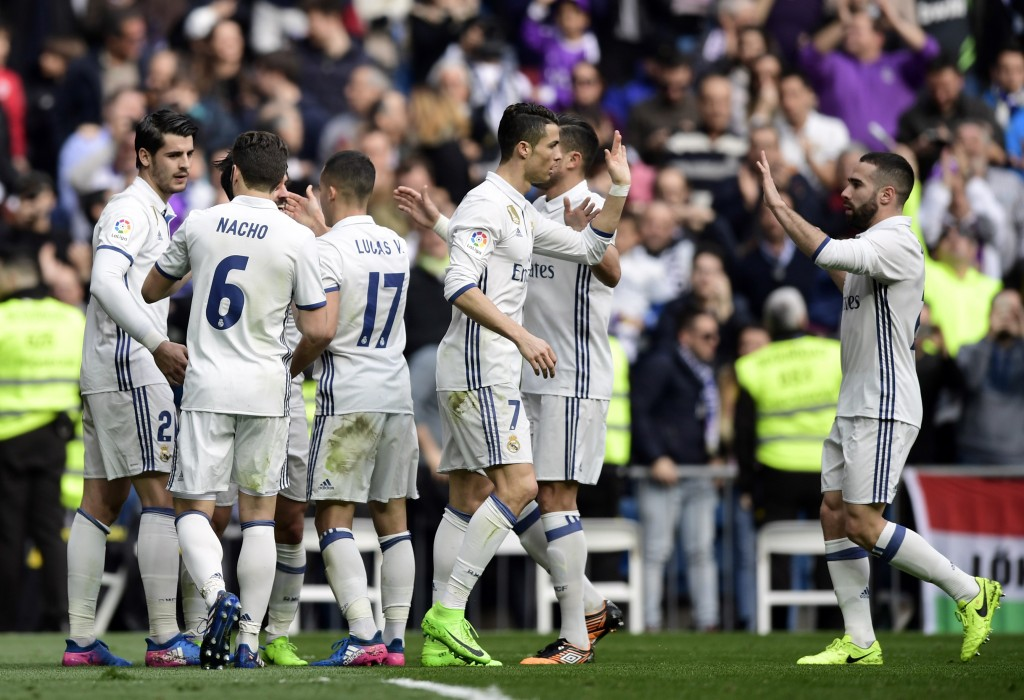 Real Madrid players celebrate a goal during the Spanish league football match Real Madrid CF vs RCD Espanyol at the Santiago Bernabeu stadium in Madrid on February 18, 2017. / AFP / JAVIER SORIANO (Photo credit should read JAVIER SORIANO/AFP/Getty Images)