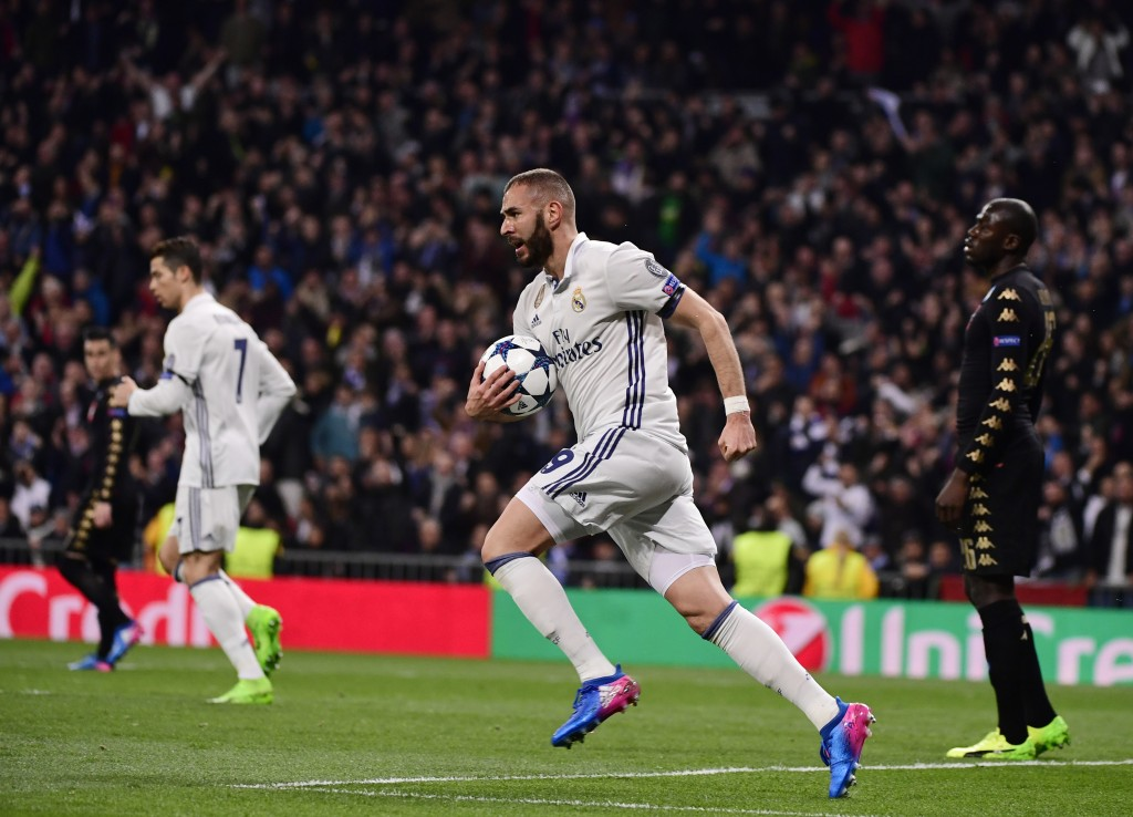 Real Madrid's French forward Karim Benzema (C) celebrates a goal during the UEFA Champions League round of 16 first leg football match Real Madrid CF vs SSC Napoli at the Santiago Bernabeu stadium in Madrid on February 15, 2017. / AFP / PIERRE-PHILIPPE MARCOU (Photo credit should read PIERRE-PHILIPPE MARCOU/AFP/Getty Images)