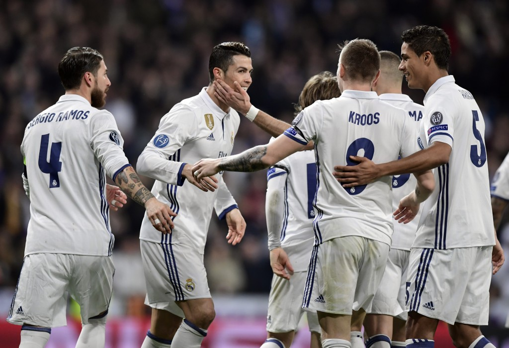 Real Madrid's Portuguese forward Cristiano Ronaldo (2L) and teammates celebrate their third goal during the UEFA Champions League round of 16 first leg football match Real Madrid CF vs SSC Napoli at the Santiago Bernabeu stadium in Madrid on February 15, 2017. / AFP / JAVIER SORIANO (Photo credit should read JAVIER SORIANO/AFP/Getty Images)
