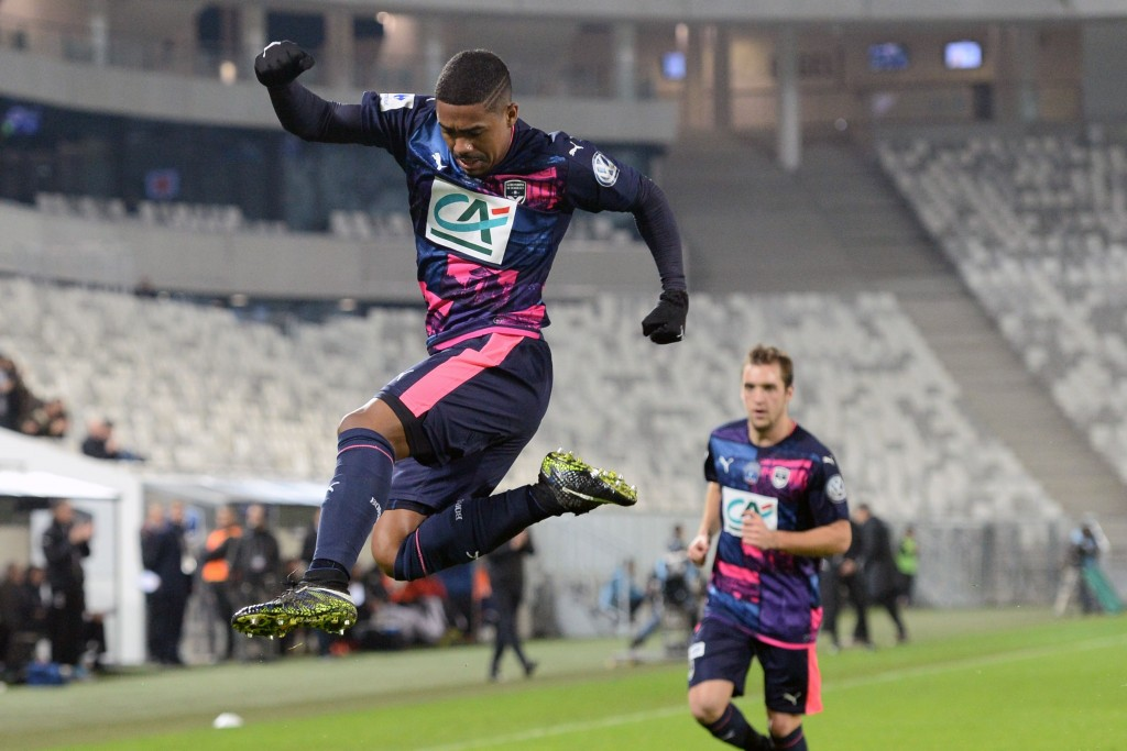 Bordeaux's Brazilian forward Malcom celebrates after scoring a goal during the French Cup football match between Bordeaux (FCGB) and Dijon on January 31, 2017 at the Matmut Atlantique stadium in Bordeaux, southwestern France. / AFP / NICOLAS TUCAT (Photo credit should read NICOLAS TUCAT/AFP/Getty Images)