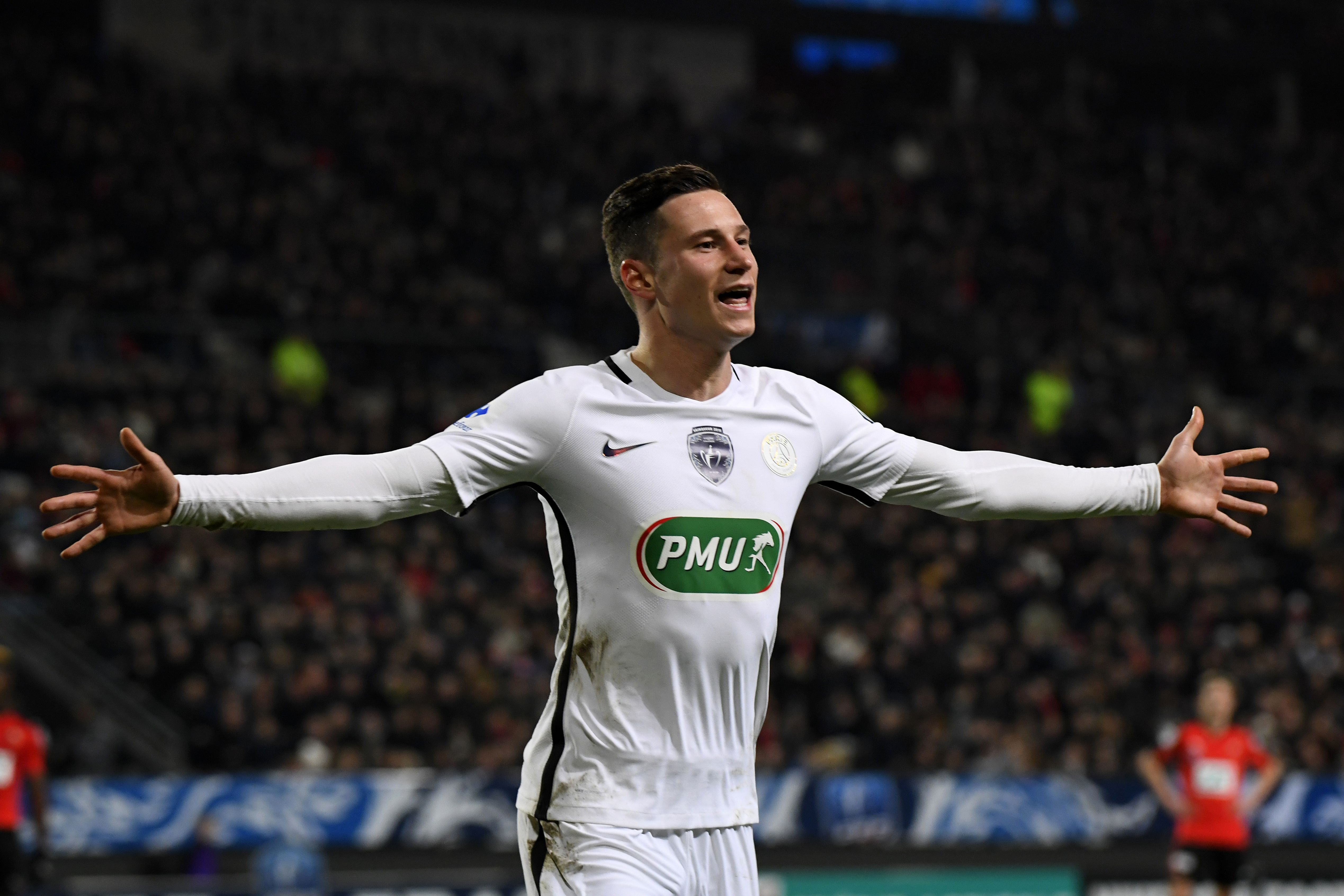 Paris Saint-Germain's German forward Julian Draxler celebrates after scoring a goal during the French Cup football match Rennes against Paris Saint Germain on February 1, 2017 at the Roahzon Park stadium in Rennes, western France. / AFP / DAMIEN MEYER (Photo credit should read DAMIEN MEYER/AFP/Getty Images)