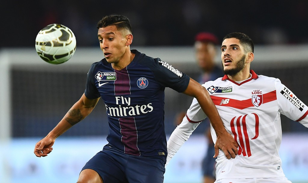 Paris Saint-Germain's Brazilian defender Marquinhos (L) controls the ball next to Lille's French forward Yassine Benzia during the French League Cup football match between Paris Saint-Germain and Lille at the Parc des Princes stadium in Paris on December 14, 2016. / AFP / FRANCK FIFE (Photo credit should read FRANCK FIFE/AFP/Getty Images)